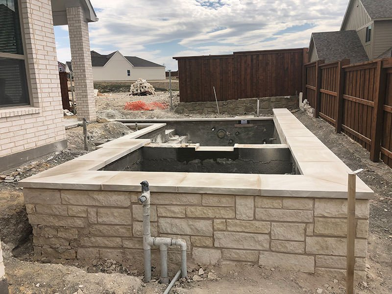 Pool & Spa with coping and stone veneer