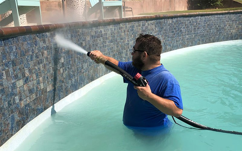 Dustless Blasting to clean pool tile calcium