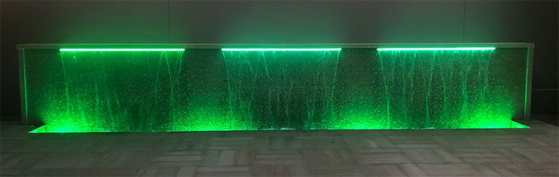 Green LED light on custom waterfall built by Willsha Pools