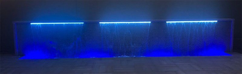 Purple LED lights on custom water feature built by Willsha Pools