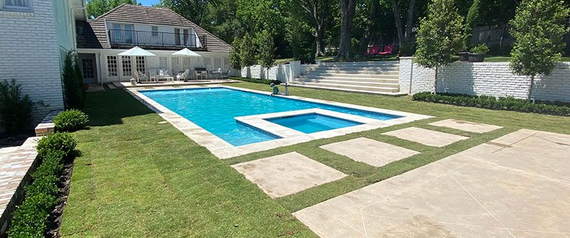 Completed Pool Remodel project with landscaping