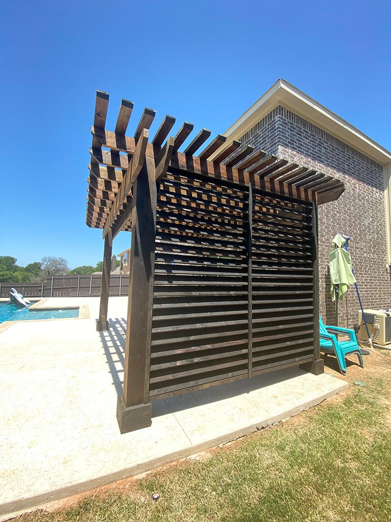 Pergola with louvered privacy wall